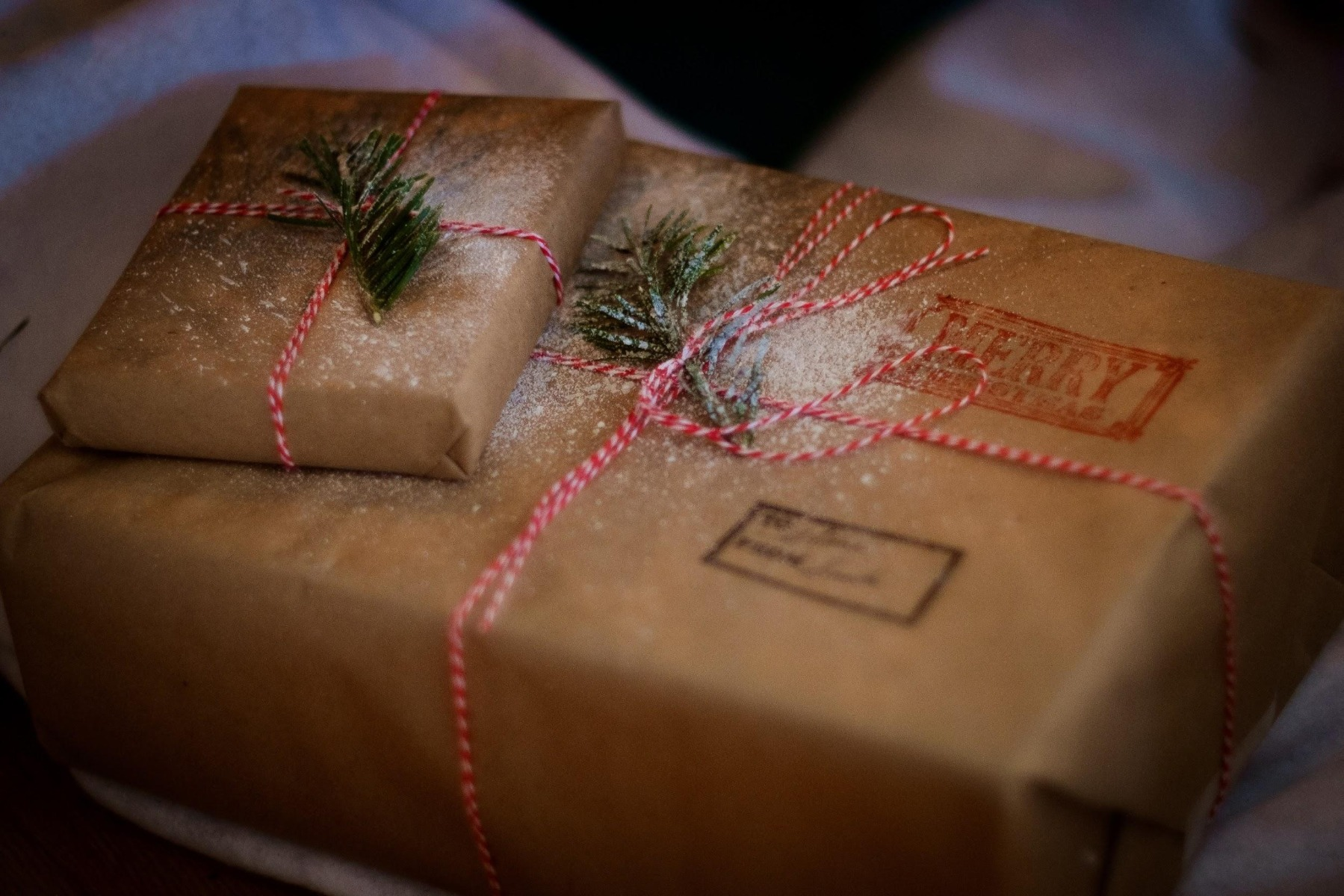 Two paper-wrapped Christmas packages